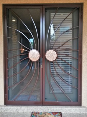 Pair of security pre hung screen doors in wind blown copper sun design