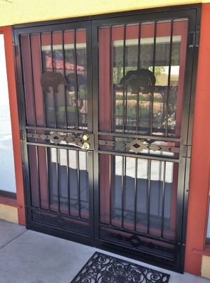 Pair of security pre hung doors with zuni bears on top and high desert design on middle and bottom