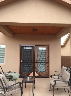 Security screen door with stationary panel in Sunray with Copper design