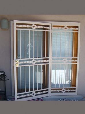 Security pre-hung screen door with sidelight in High Desert design