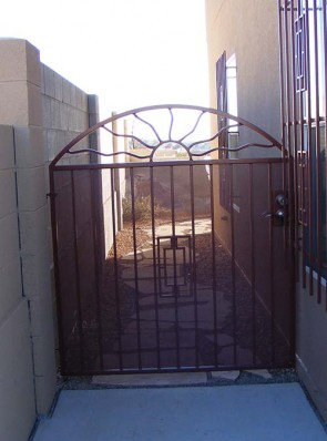 Arched gate with Wavy Sun and Contemporary design and perforated metal