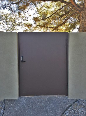 Gate with solid metal and keypad lock