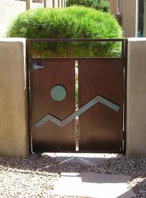 Custom gate with solid metal mounted in moon design
