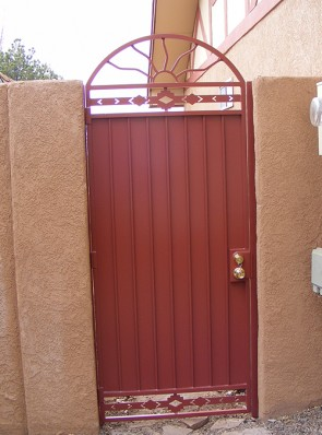 Arched gate with Wavy Sun, High Desert design and solid metal