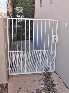 Gate with expanded metal on bottom