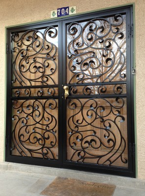 Pair of security storm doors in forged design