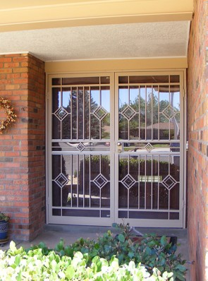 Pair of security storm doors in diamond design