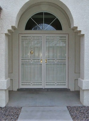 Pair of security storm doors in high desert design