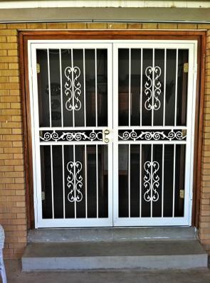 Pair of security storm doors in heritage design