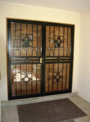 Pr. of Security storm doors in Zia design with High Desert center