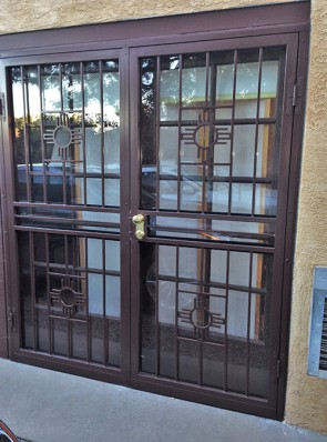 Pair of security storm doors in Zia design with straight bars in the center