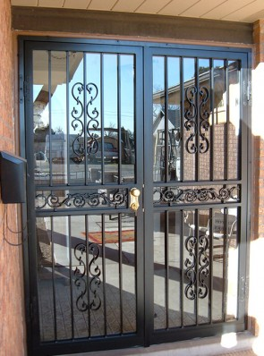 Pr. of security storm doors in Heritage design with center frieze  and black color
