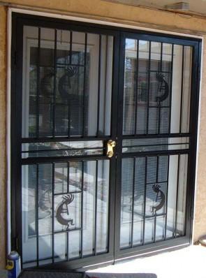 Pair of security storm doors in kokopelli design