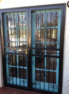 Pair of security storm doors in heart design