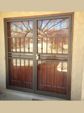 Pair of security storm doors with split wavy sun on top and knuckles design