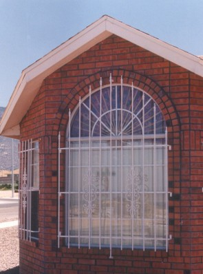Arched window grill with Spears and Caprice design