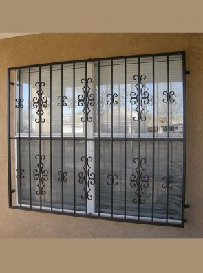 Framed window grill in Seville and C scroll design