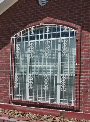Eyebrow top window grill with Sunbird and C scrolls design