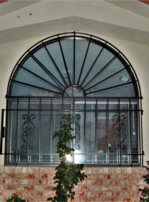 Arched window grill in Sunray and Sunbird design