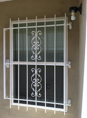 Security window grill with Emergency Fire Release in Sunbird design