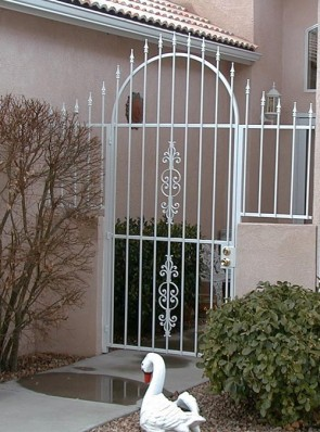 Arched gate with spears, wall topper and Caprice design